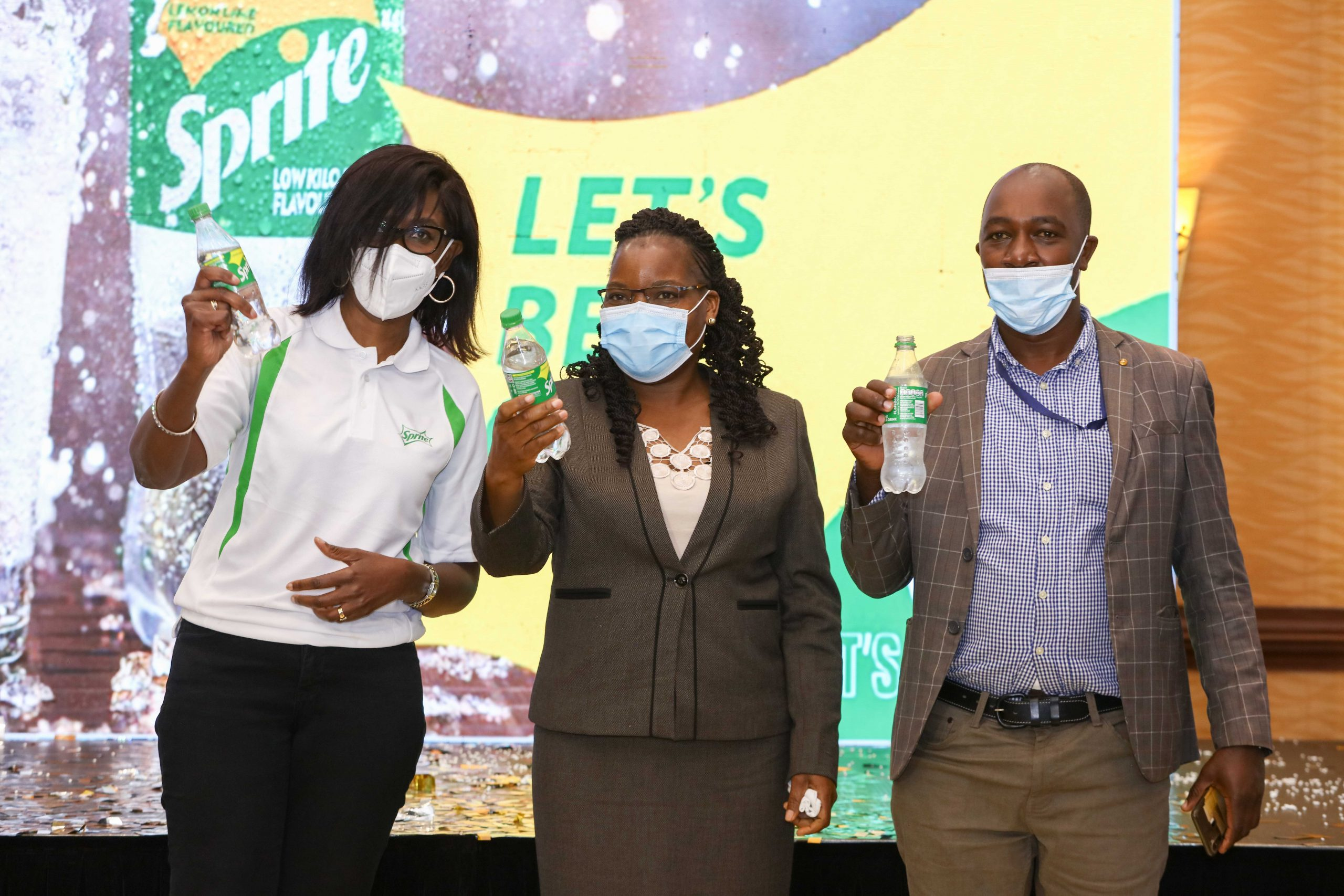 From left, Debra Mallowah, Vice President, Coca-Cola East and Central Africa Franchise, Dr. Catherine Mbaisi, Deputy Director - NEMA and Geoffrey Kuria of Kenya Association of Waste Recyclers pose for a photo during the launch of Sprite's new clear recyclable bottle at Serena Hotel.