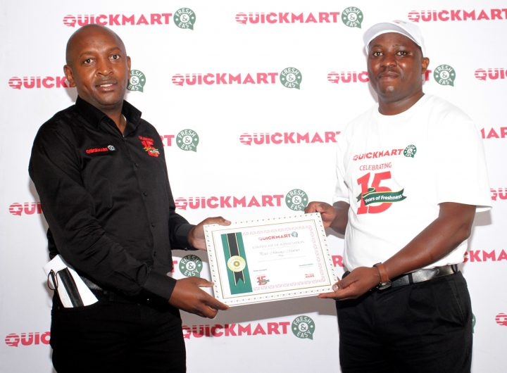 Quickmart-Supermarket-CEO-Peter-Kangiri-presents-a-certificate-of-appreciation-to-one-of-the-longest-serving-staff-Peter-Mwangi-during-the-retailers-15years-anniversary-at-Kilimani-branch.(photo;courtesy)