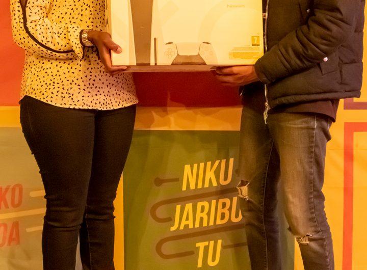 Wanjiru-Njenga-Head-of-Marketing-Suntory-Beverage-Food-and-James-Merigi-PS5-Winner-Lucozade-Final-11-League-Winner-2.(photo;courtesy